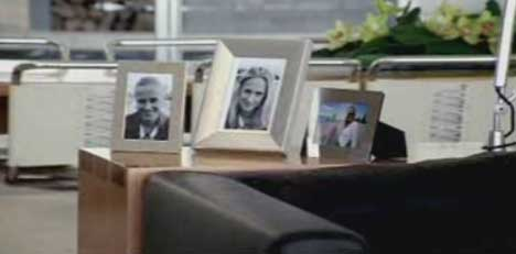 Photographs on desk in White Ribbon Day TV Ad