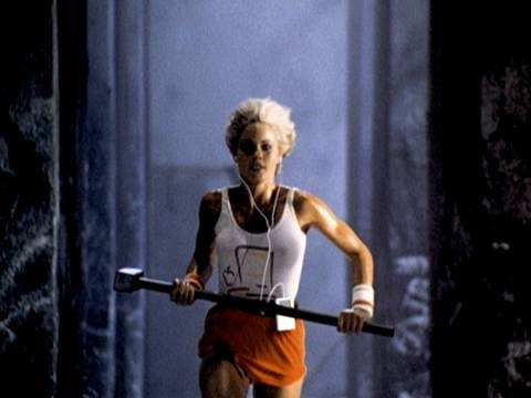 Women runs with hammer in Apple 1984 TV Ad
