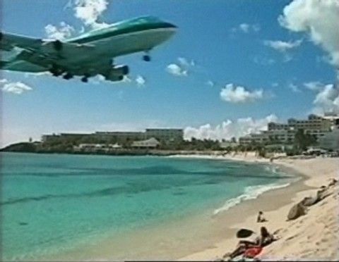 Plane flies over beach for Bigpond Beach Holiday TV Ad