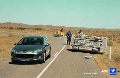 Peugeot 407 passes rolled toy car in TV ad