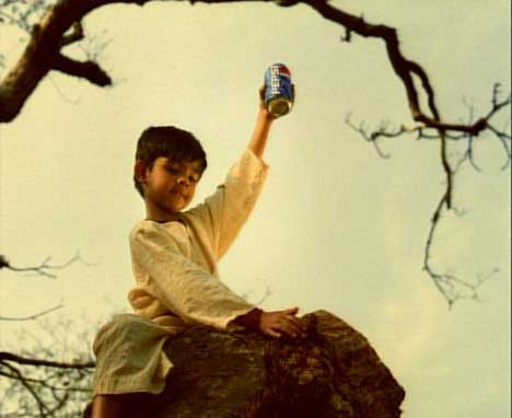 Boy on Elephant with Pepsi