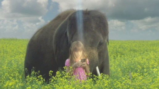 Girl and elephant in Texas Instruments tv ad