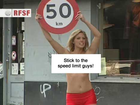 Bikini Bandit holds a 50 km speed limit sign