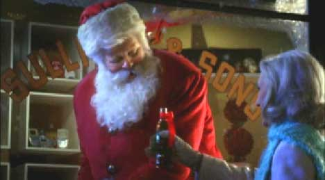 Woman gives a bottle of Coca-Cola to Santa