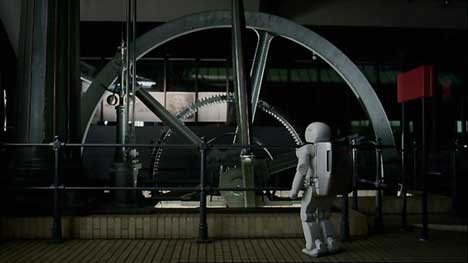Asimo inspects a flywheel in Honda TV ad