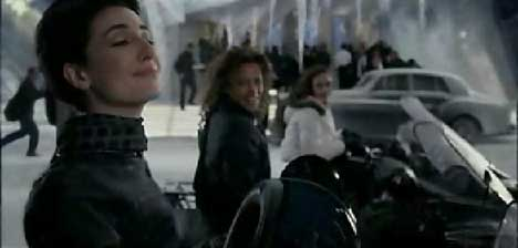 Models pose on snowmobiles in Marks & Spencer's TV advert