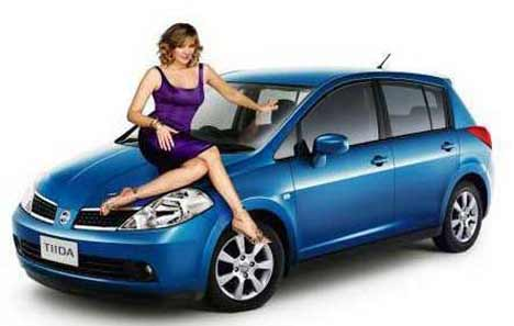 Kim and blue Nissan Tiida
