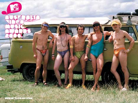 Shayne fills the truck dressed in his budgie smugglers