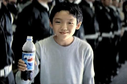 Boy bows with reverence in Pepsi TV Ad