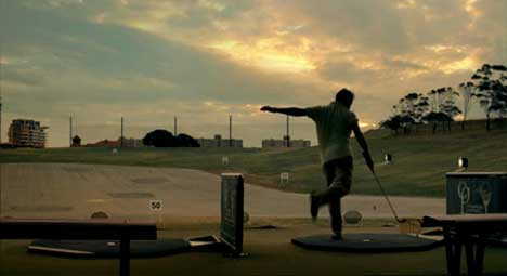 Golfer kicks ball in Qantas Football advertisement