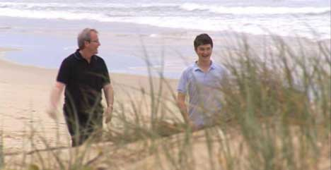 Kevin Rudd on beach with his son