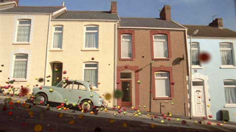 Fruit bounces past houses in Swansea
