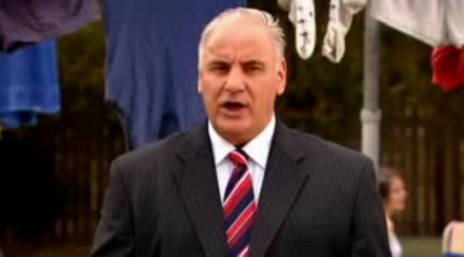 Sam Kekovich says We Love Our Lamb in front of Australian flag