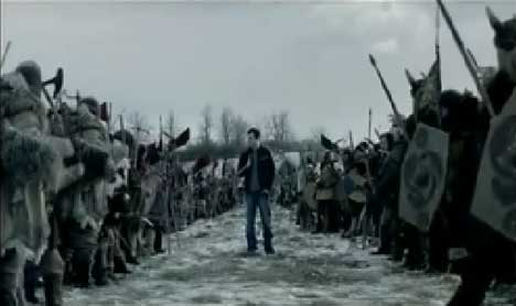 Snickers man stands in the middle of two opposing armies