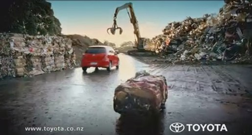 Toyota Yaris leaves behind the flattened remains of a tow truck