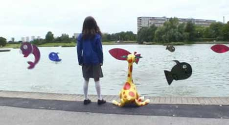 Girl and giraffe play with imaginary fish in NSPCC TV ad