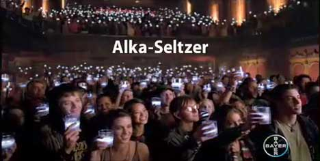 Crowd holding glowing glasses in Alka Seltzer TV ad
