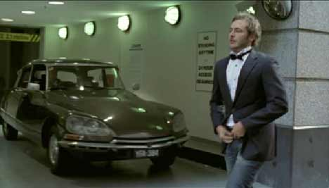 Man wears black bow tie walking past Citroen in Honda CRV TV ad
