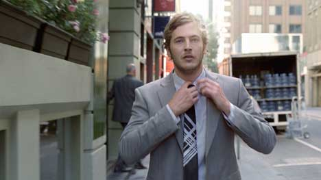 Man wears suit and tie in Honda CRV TV ad