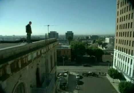Man on edge of high building in VW TV ad