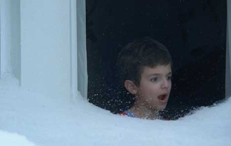 Boy looks at snow through window in Windows Vista TV ad