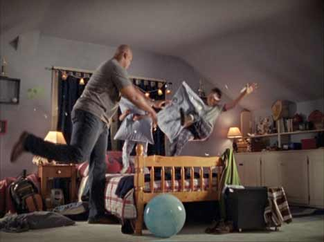 Frank Thomas in pillow fight with two boys
