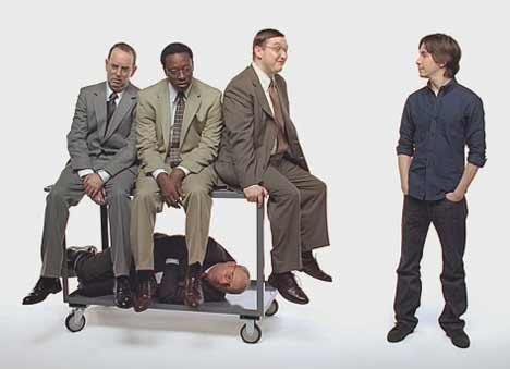 PC and colleagues on cart in Get A Mac ad