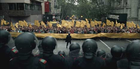 Protesters and riot police in Absolut TV ad