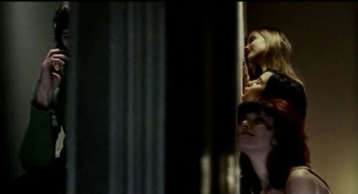 Woman caress the walls of the boy next door in Lynx TV ad