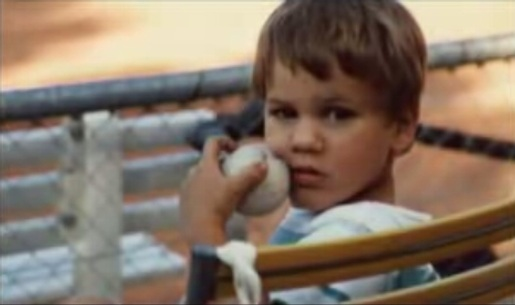 Roger Federer as a boy holding ball