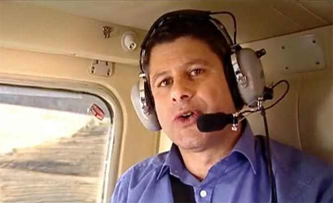 Steve Bracks in a helicopter filming a water conservation message