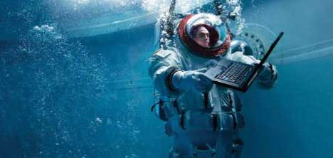 Diver and notebook in Lenovo Water Test