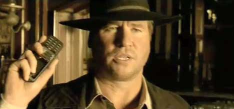 Val Kilmer holds a cellphone in Orange cinema ad