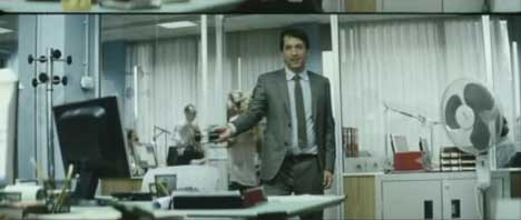 Office worker arrives back from lunch in Vodafone Time Theft TV advert