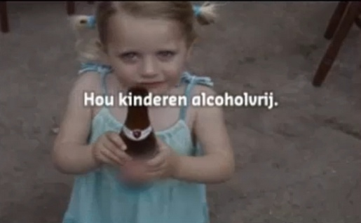 Child drinking alcohol in home video