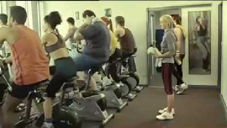Queue for the exercycles in Fernwood Bike TV ad