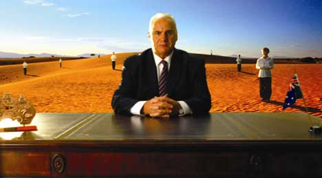 Sam Kekovich in the desert with choir boys and girls
