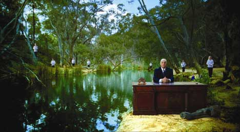 Sam Kekovich by a river with choir boys and girls