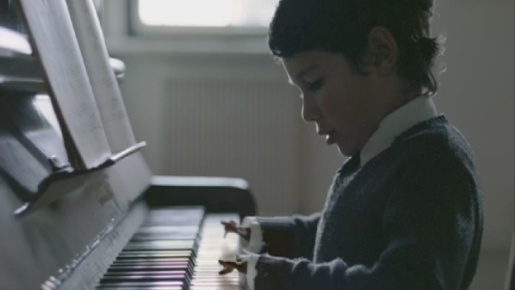 Herringbone Henri plays piano as a child