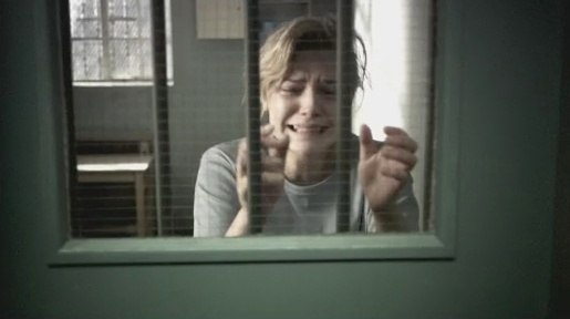 Woman behind bars in Barnardo's Break The Cycle TV advert