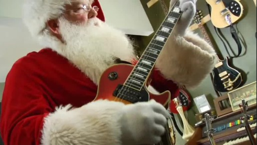 Santa plays guitar in Thwak video