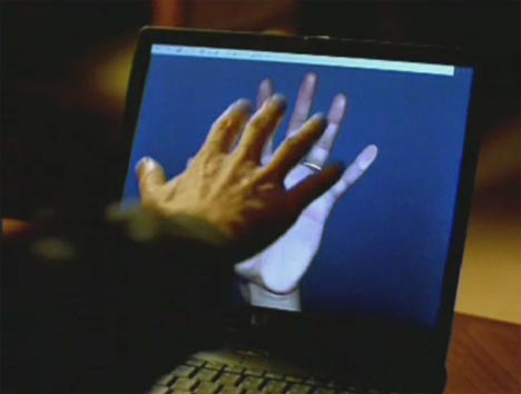 Hands in Telecom Heartscan TV ad
