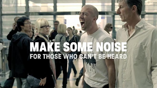 Make Some Noise Man in shopping mall yells in Amnesty ad