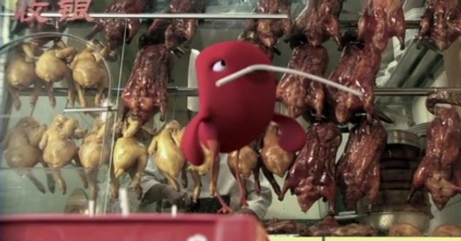 Bird collects straw in Coca Cola Birds Nest TV ad