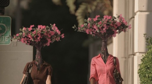 Women walk with flowers for heads in Getty Center TV commercial