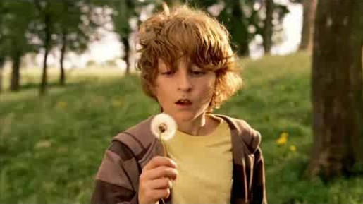 Boy holds dandelion in The Cooperative TV advert