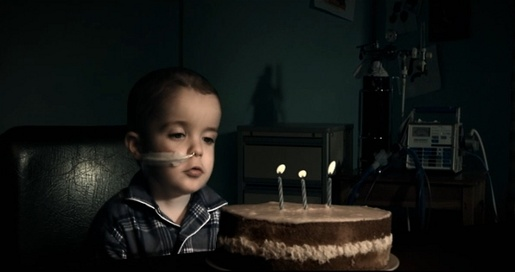 Child blows three candles in Starship Blow TV commercial