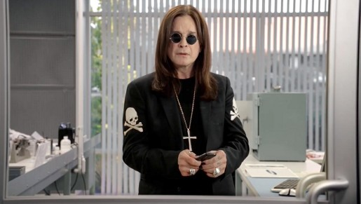 Ozzy Osbourne with Samsung Solstice cell phone