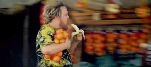 Man running with banana in Visa Football Evolution ad