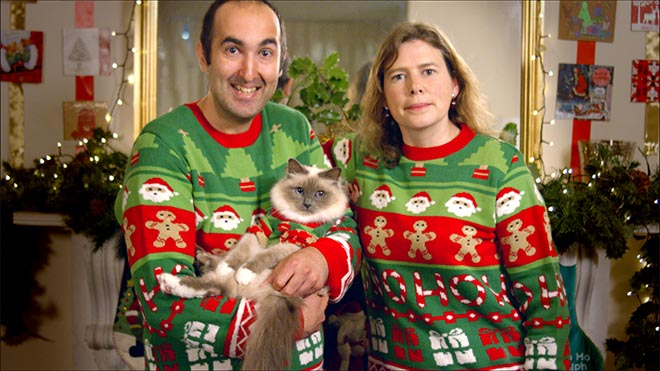 Cat dressed up with couple in Temptations commercial